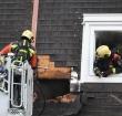 Schade aan dak na woningbrand aan Akkerwinde